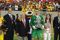 Title sponsor Aaron's founder, Charlie Loudermilk, along with granddaughter, Chappell Loudermilk, and goalkeeper Shay Given are surprised by a visit from the Aaron's Lucky Dog. The 2010 Atlanta International Soccer Challenge was held, Wednesday, July 28, at the Georgia Dome, featuring a match between Club America and Manchester City. After regulation time ended 1-1, Manchester City was awarded the victory, winning 4-1, in penalty kicks.