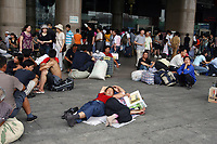 CHINA. Beijing. Migrant workers and travellers outside of Beijing West Train Station. 2007.