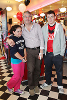 """NO REPRO FEE. 26/5/2011. NEW EDDIE ROCKET'S SHAKE SHOP. Colm Hayes with Holly and Alex are pictured in the new Eddie Rocket's Shake Shop. The design seeks to recall the vintage milkshake bars from 1950's America and re-imagine them for the 21st century. The new look aims to appeal to both young and old with a quirky and bold colour scheme and a concept of make-your-own milkshakes, based on the tag line """"You make it...We shake it!"""". Eddie Rocket's City Diner in the Stillorgan Shopping Centre in south Dublin has re-opened after an exciting re-vamp and the addition of a Shake Shop. Ten new jobs have been created with the Diner's re-launch bringing the total working in Eddie Rocket's Stillorgan to 30. Picture James Horan/Collins Photos"""