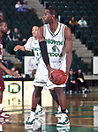 North Texas Mean Green forward George Odufuwa (4) prepares to pass the ball in the game between the Texas State Bobcats and the University of North Texas Mean Green at the North Texas Coliseum,the Super Pit, in Denton, Texas. UNT defeated Texas State 85 to 62