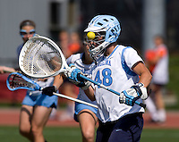 Logan Ripley (48) of North Carolina saves a goal with her helmet during the ACC women's lacrosse tournament semifinals in College Park, MD.  North Carolina defeated Duke, 14-4.