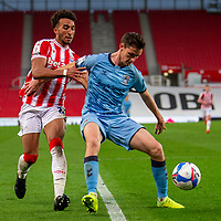 21st April 2021; Bet365 Stadium, Stoke, Staffordshire, England; English Football League Championship Football, Stoke City versus Coventry; Dominic Hyam of Coventry City under pressure from  Jacob Brown of Stoke City