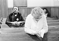 """Two Atlantans pray at a vigil being kept for the missing and murdered children of the city, Feb. 27, 1981. The church committee of the NAACP organized the vigil not only for the children, """"but for the killer too,"""" said committee member Shirley Harris. (AP Photo/Gary Gardiner)"""