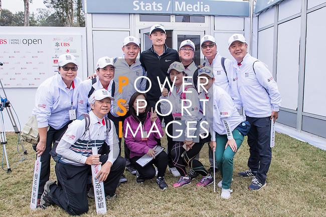 Haotong Li of China poses for a photo with the fans during the day three of UBS Hong Kong Open 2017 at the Hong Kong Golf Club on 25 November 2017, in Hong Kong, Hong Kong. Photo by Marcio Rodrigo Machado / Power Sport Images