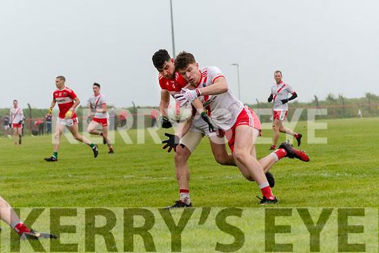 An Ghaeltacht Cathal Ó Beaglaoich tackled by Daingean Uí Chúis Micheal Ó Geibheannaigh during the West Kerry Senior Football Championship Final at Gallarus on Sunday afternoon.