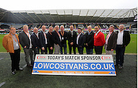 Match sponsors with Lee Trundle before the Barclays Premier League match between Swansea City and Crystal Palace at the Liberty Stadium, Swansea on February 06 2016