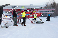 Volunteer Iditarod Air Force pilots line up their planes as they wait to load straw, musher drop bags, people food and HEET  at the Willow, Alaska airport during the Food Flyout on Saturday, February 20, 2016.  Iditarod 2016