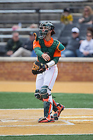 Miami Hurricanes catcher Garrett Kennedy (40) on defense against the Wake Forest Demon Deacons at Wake Forest Baseball Park on March 22, 2015 in Winston-Salem, North Carolina.  The Demon Deacons defeated the Hurricanes 10-4.  (Brian Westerholt/Four Seam Images)