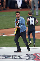 Cincinnati, Ohio based Walk the Moon - guitarist Eli Maiman - perform before the MLB Home Run Derby on July 13, 2015 at Great American Ball Park in Cincinnati, Ohio.  (Mike Janes/Four Seam Images)