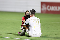 CARY, NC - AUGUST 01: Alex Crognale #21 is checked for a concussion by trainer Maggi Campanaro during a game between Birmingham Legion FC and North Carolina FC at Sahlen's Stadium at WakeMed Soccer Park on August 01, 2020 in Cary, North Carolina.