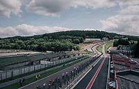 the peloton racing on the Circuit de Spa-Francorchamps over F1's (most) legendary bend Eau Rouge<br /> <br /> 104th Tour de France 2017<br /> Stage 3 - Verviers › Longwy (202km)