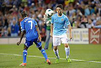 The ball drops between Ramires (7) Chelsea and Smir Nasri, Manchester City..Manchester City defeated Chelsea 4-3 in an international friendly at Busch Stadium, St Louis, Missouri.