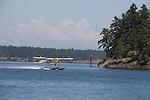 San Juan Island, float plane, Kenmore Air, DeHavilland Beaver landing off Friday Harbor, San Juan Islands, Washington State, Pacific Northwest,