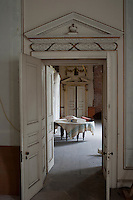 A restored pediment graces the open double doorway to the drawing room