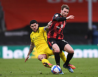 13th March 2021; Vitality Stadium, Bournemouth, Dorset, England; English Football League Championship Football, Bournemouth Athletic versus Barnsley; Alex Mowatt of Barnsley competes for the ball with Jack Stacey of Bournemouth