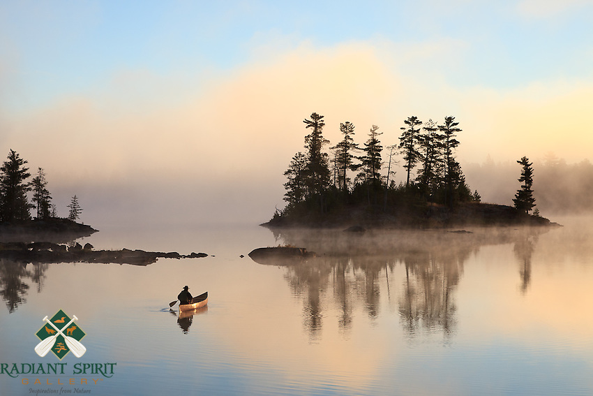 """""""Paddling to Sunrise""""<br /> <br /> The canoeist paddles toward the foggy sunrise in the Boundary Waters Canoe Area Wilderness (BWCAW). The wilderness provides an abundance of solitude and serenity for the soul."""
