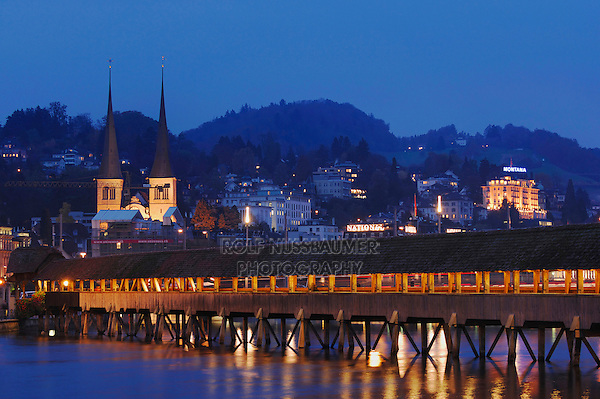 Chapel Bridge and Hof church at dusk, Lucerne, Switzerland