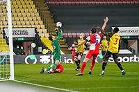 Scott Kashket of Wycombe Wanderers goes down under a challenge from Goalkeeper Daniel Bachmann of Watford during the Sky Bet Championship behind closed doors match between Watford and Wycombe Wanderers at Vicarage Road, Watford, England on 3 March 2021. Photo by David Horn.