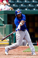 Tyler Ladendorf (5) of the Midland RockHounds makes contact on a pitch during a game against the Springfield Cardinals on April 19, 2011 at Hammons Field in Springfield, Missouri.  Photo By David Welker/Four Seam Images