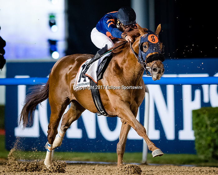DUBAI, UNITED ARAB EMIRATES - MARCH 25: Mind Your Biscuits #14 ridden by Joel Rosario (blue hat), wins the Dubai Golden Shaheen at Meydan Racecourse during Dubai World Cup Day on March 25, 2017 in Dubai, United Arab Emirates. (Photo by Douglas DeFelice/Eclipse Sportswire/Getty Images)