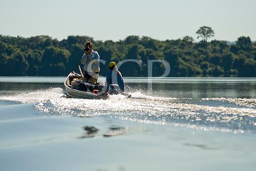 Mato Grosso State, Brazil. Xingu River; Von Martius falls; Patrick Cunningham, video camera in hand with Waiwai Txucarramae.