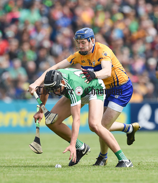 Gearoid Hegarty of Limerick in action against David Fitzgerald of Clare during their Munster championship game in Ennis. Photograph by John Kelly.