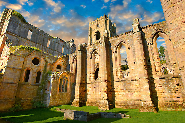 Exterior at sunrise  of Fountains Abbey , founded in 1132, is one of the largest and best preserved ruined Cistercian monasteries in England. The ruined monastery is a focal point of England's most important 18th century Water, the Studley Royal Water Garden which is a UNESCO World Heritage Site. Near Ripon, North Yorkshire, England