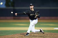 Wake Forest Demon Deacons relief pitcher Antonio Menendez (27) delivers a pitch to the plate against the Notre Dame Fighting Irish at David F. Couch Ballpark on March 10, 2019 in  Winston-Salem, North Carolina. The Fighting Irish defeated the Demon Deacons 8-7 in 10 innings in game two of a double-header. (Brian Westerholt/Four Seam Images)