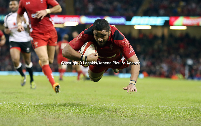 Pictured: Taulupe Faletau scoring a try for Wales. Saturday 15 November 2014<br /> Re: Dove Men Series rugby, Wales v Fiji at the Millennium Stadium, Cardiff, south Wales, UK.