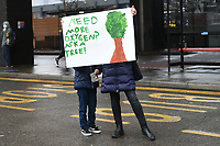 A 'Need More Oxygen? Ask A Tree' sign is held up during a protest against the building of the HS2 railway line at Euston Square Gardens on 27th January 2021