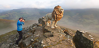 Pictured: A full size composite fibreglass lion on the summit of Sugarloaf mountain in south Wales, UK.<br /> Re: Lion is full size and made of a composite fibreglass resin. Weighs around 35 kilos.<br /> Lion was carried up to the Summit of Sugarloaf by Steve Bancroft and Mark Taylor by using a heavy duty trolley to wheel the lion 75% of the distance from the car park up the mountain along a fairly smooth path. <br /> As the climb got steeper, the trolley was ditched and the lion was physically carried the rest of the ascent.