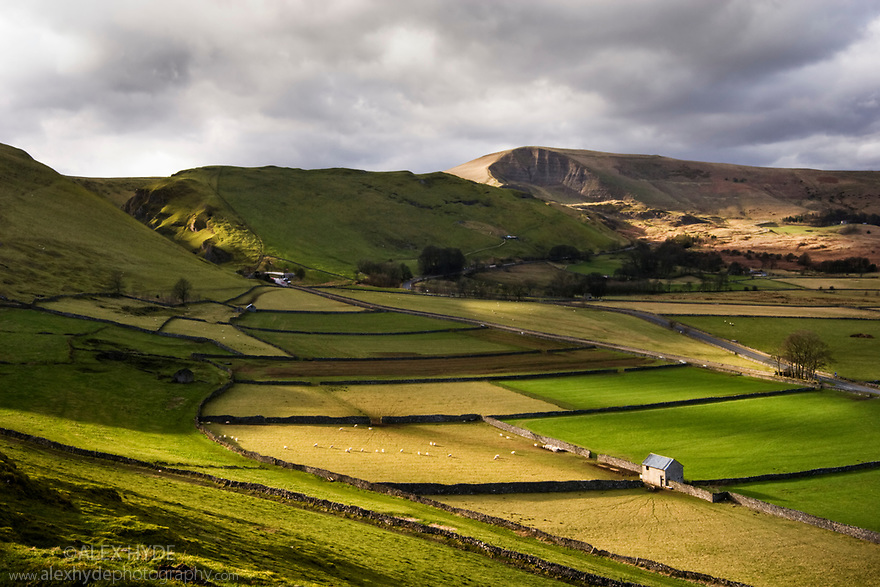 Fields in storm light, looking over to Winnats Pass, Peak District National Park, Derbyshire,  UK.