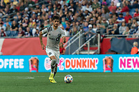 FOXBOROUGH, MA - JULY 25: Emanuel Maciel #25 of CF Montreal brings the ball forward during a game between CF Montreal and New England Revolution at Gillette Stadium on July 25, 2021 in Foxborough, Massachusetts.