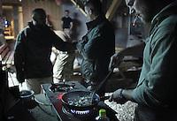 Afghanistan, 22.10.2011, Nawabad. Im District Headquarters mixen Soldaten Fertigmahlzeiten und kochen daraus Abendessen. Die in Kundus stationierte 3. Task Force (ISAF) der Bundeswehr beginnt im Oktober 2011 die mehrtaegige Operation Orpheus. Durch Patrouillen in und um die Kleinstadt Nawabad (Dirstrikt Chahar Dareh) westlich von Kundus, Nordafghanistan, versuchen die rund 100 Infanteristen Rueckzugsorte Aufstaendischer unmoeglich zu machen. Unterstuetzt werden sie dabei durch einen Zug afghanischer Soldaten. Soldiers in the District Headquarters near Nawabad cook dinner by mixing different NATO Ready-to-Eat Meals. In October 2011 Kunduz based 3.Task Force started a several days operation in and around Nawabad (District Chahar Dareh), west of Kunduz, northern Afghanistan. During the Operation Orpheus about 100 german infantry soldiers went out for patrols through the town and surrounding areas, which were expected as a retreat zone of insurgents. A platoon of afghan soldiers supports the german forces. © Timo Vogt/Est&Ost, NO MODEL RELEASE !! © Timo Vogt/Est&Ost, NO MODEL RELEASE !!