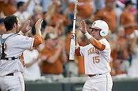 Texas Longhorn outfielder Mark Payton #15 celebrates after scoring against the Arizona State Sun Devils  in NCAA Tournament Super Regional Game #3 on June 12, 2011 at Disch Falk Field in Austin, Texas. (Photo by Andrew Woolley / Four Seam Images)