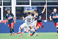 FOXBOROUGH, MA - JULY 25: Joaquín Torres #18 of CF Montreal comes in to tackle Matt Polster #8 of New England Revolution during a game between CF Montreal and New England Revolution at Gillette Stadium on July 25, 2021 in Foxborough, Massachusetts.