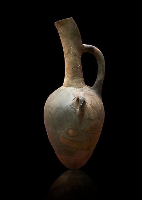 Hittite long neck beak spout pointed base terra cotta vessel. Hittite Old Period, 1650 - 1450 BC. Huseyindede. Çorum Archaeological Museum, Corum, Turkey. Against a black bacground.