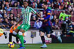 Sidnei Rechel Da Silva Junior of Real Betis (L) competes for the ball with Lionel Andres Messi of FC Barcelona during the La Liga 2018-19 match between FC Barcelona and Real Betis at Camp Nou, on November 11 2018 in Barcelona, Spain. Photo by Vicens Gimenez / Power Sport Images