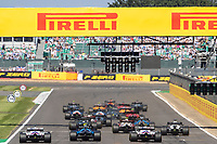18th July 2021; Silverstone Circuit, Silverstone, Northamptonshire, England; Formula One British Grand Prix, Race Day; The cars speed into the first corner at the start of the race