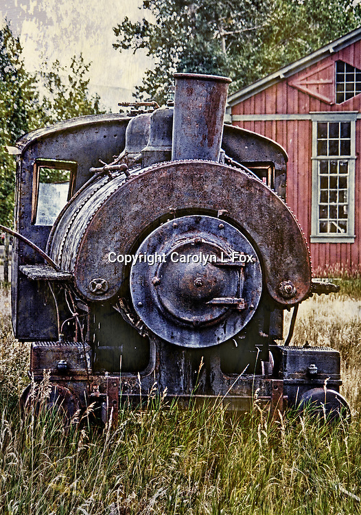 An old train engine sits in a small town in Montana.
