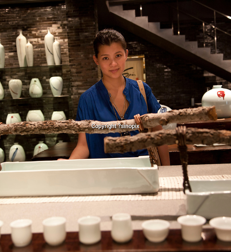 Spin - A high fashion lucury table/decoware shop on Kanding Road. Series of images looking at 'Trendy Shanghai' By Jonathan Browning.