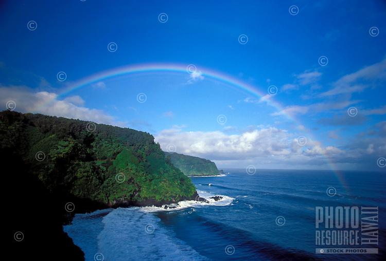 Morning rainbow on the road to Hana, Maui near Keanae.