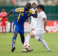David Carranza (11) of Honduras tries to take the ball away from Jabarry Chandler (11) of Barbados during the group stage of the CONCACAF Men's Under 17 Championship at Catherine Hall Stadium in Montego Bay, Jamaica. Honduras defeated Barbados, 2-1.
