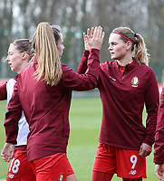 Sophie Henrica Cora Cobussen (22) of Standard and Sylke Calleeuw (9) of Standard  give high five before a female soccer game between Standard Femina de Liege and Sporting Charleroi on the 16th matchday of the 2020 - 2021 season of Belgian Scooore Womens Super League , saturday 13 th of February 2021  in Angleur , Belgium . PHOTO SPORTPIX.BE | SPP | SEVIL OKTEM