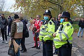 Police with masks at Speakers' Corner after declaring a health incident due to overcrowding and failure to follow Covid-19 guidelines.  Hyde Park, London.