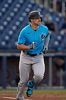 Miami Marlins Adam Duvall (14) runs to first base during a Major League Spring Training game against the Washington Nationals on March 20, 2021 at FITTEAM Ballpark of the Palm Beaches in Palm Beach, Florida.  (Mike Janes/Four Seam Images)
