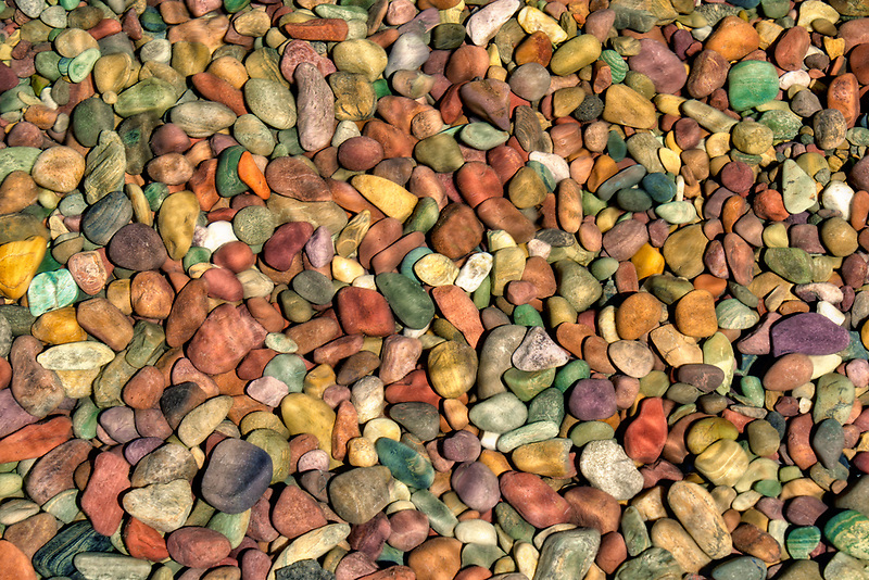 Colorful rocks on shore of Lake McDonald. Glacier National Park, Montana