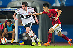 (L) Pierre-Emile Hojbjerg of Bayern Munich competes for the ball during the Bayern Munich vs Guangzhou Evergrande as part of the Bayern Munich Asian Tour 2015  at the Tianhe Sport Centre on 23 July 2015 in Guangzhou, China. Photo by Aitor Alcalde / Power Sport Images
