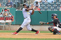 Albert Cartwright (13) of the Reading Fightin Phils bats in front of catcher Jairo Rodriguez during a game against the New Britain Rock Cats at New Britain Stadium on July 13, 2014 in New Britain, Connecticut.  Reading defeated New Britain 6-4.  (Gregory Vasil/Four Seam Images)
