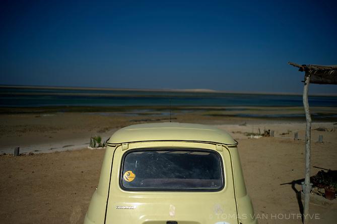 A late model Renault is seen near a lagoon in the Western Sahara desert near Dakhla, Morocco on Dec. 16, 2011.